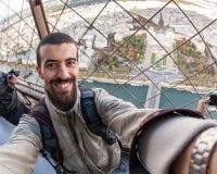 Man on Tour Eiffel. Young Man on the top of Tour Eiffel in Paris Stock Photo
