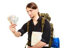 Man tourist backpacker holding euro money. Travel. Royalty Free Stock Image