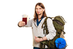 Man tourist backpacker holding money and passport. Stock Photography