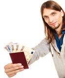 Man tourist backpacker holding money and passport. Royalty Free Stock Photo