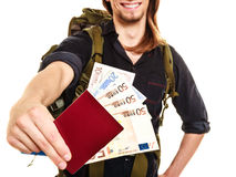 Man tourist backpacker holding money and passport. Stock Images