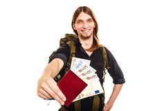Man tourist backpacker holding money and passport. Royalty Free Stock Image