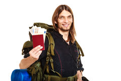 Man tourist backpacker holding money and passport. Royalty Free Stock Photo