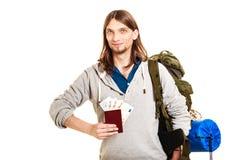 Man tourist backpacker holding money and passport. Stock Photos