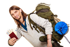 Man tourist backpacker holding money and passport. Stock Photography