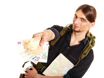 Man tourist backpacker paying euro money. Travel. Royalty Free Stock Image