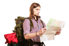 Man tourist backpacker reading map. Summer travel. Man tourist backpacker reading map on trip. Young guy hiker searching looking for direction guide. Male Royalty Free Stock Image