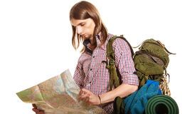 Man tourist backpacker reading map. Summer travel. Man tourist backpacker reading map on trip. Young guy hiker searching looking for direction guide. Male Royalty Free Stock Images