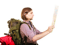 Man tourist backpacker reading map. Summer travel. Man tourist backpacker reading map on trip. Young guy hiker searching looking for direction guide. Male Stock Images