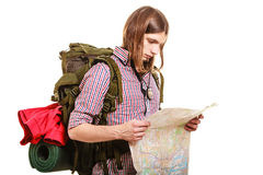 Man tourist backpacker reading map. Summer travel. Man tourist backpacker reading map on trip. Young guy hiker searching looking for direction guide. Male Stock Photography