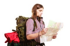 Man tourist backpacker reading map. Summer travel. Man tourist backpacker reading map on trip. Young guy hiker searching looking for direction guide. Male Stock Image