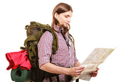 Man tourist backpacker reading map. Summer travel. Royalty Free Stock Photo