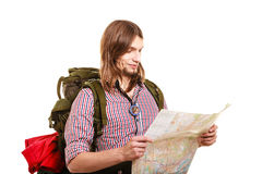 Man tourist backpacker reading map. Summer travel. Royalty Free Stock Image