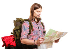 Man tourist backpacker reading map. Summer travel. Man tourist backpacker reading map on trip. Young guy hiker searching looking for direction guide. Male Royalty Free Stock Photo