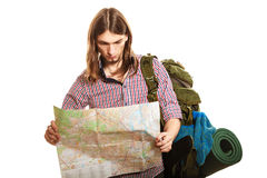 Man tourist backpacker reading map. Summer travel. Man tourist backpacker reading map on trip. Young guy hiker searching looking for direction guide. Male Royalty Free Stock Photography