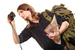 Man tourist backpacker taking photo with camera. Royalty Free Stock Photography