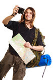 Man tourist backpacker taking photo with camera. Man tourist backpacker on trip taking photo picture with camera. Young guy hiker backpacking holding map Royalty Free Stock Photography