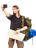 Man tourist backpacker taking photo with camera. Stock Photography