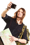 Man tourist backpacker taking photo with camera. Man tourist backpacker on trip taking photo picture with camera. Young guy hiker backpacking holding map Royalty Free Stock Photo