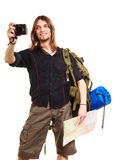 Man tourist backpacker taking photo with camera. Man tourist backpacker on trip taking photo picture with camera. Young guy hiker backpacking holding map Royalty Free Stock Photos
