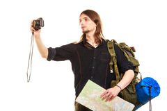 Man tourist backpacker taking photo with camera. Man tourist backpacker on trip taking photo picture with camera. Young guy hiker backpacking holding map Stock Photo