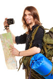 Man tourist backpacker taking photo with camera. Man tourist backpacker on trip taking photo picture with camera. Young guy hiker backpacking holding map Stock Images