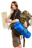 Man tourist backpacker taking photo with camera. Man tourist backpacker on trip taking photo picture with camera. Young guy hiker backpacking holding map Royalty Free Stock Images