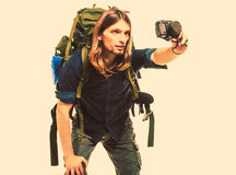 Man tourist backpacker taking photo with camera. Royalty Free Stock Images
