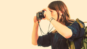 Man tourist backpacker taking photo with camera. Royalty Free Stock Photos