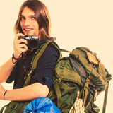 Man tourist backpacker taking photo with camera. Man tourist backpacker on trip taking photo picture with camera. Young guy hiker backpacking. Summer vacation Royalty Free Stock Photos