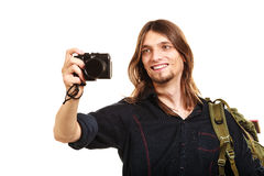 Man tourist backpacker taking photo with camera. Stock Photos