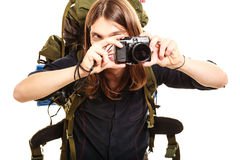 Man tourist backpacker taking photo with camera. Man tourist backpacker on trip taking photo picture with camera. Young guy hiker backpacking. Summer vacation Stock Photo