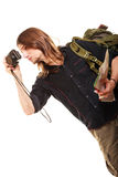 Man tourist backpacker taking photo with camera. Man tourist backpacker on trip taking photo picture with camera. Young guy hiker backpacking. Summer vacation Stock Image