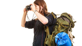 Man tourist backpacker taking photo with camera. Man tourist backpacker on trip taking photo picture with camera. Young guy hiker backpacking. Summer vacation Royalty Free Stock Image