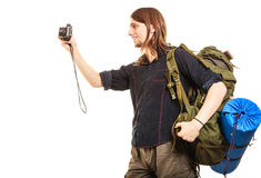 Man tourist backpacker taking photo with camera. Man tourist backpacker on trip taking photo picture with camera. Young guy hiker backpacking. Summer vacation Royalty Free Stock Photography