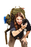 Man tourist backpacker taking photo with camera. Man tourist backpacker on trip taking photo picture with camera. Young guy hiker backpacking. Summer vacation Royalty Free Stock Photo
