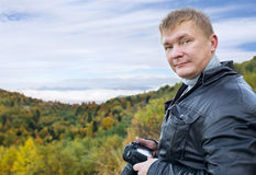 Man tourist with camera Royalty Free Stock Images