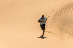Man tourist desert rub al khali Oman running in sand 3. Man tourist in desert rub al khali in Oman running in sand 3 royalty free stock images