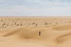 Man tourist desert rub al khali Oman running in sand 2. Man tourist in desert rub al khali in Oman running in sand 2 stock photography