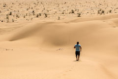 Man tourist desert rub al khali Oman running in sand. Man tourist in desert rub al khali in Oman running in sand stock photography
