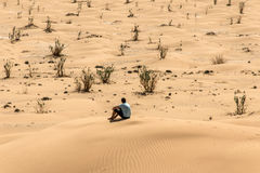 Man tourist in desert rub al khali Oman sitting sand view landscape 2 Stock Photos