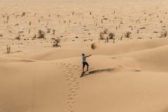 Man tourist in desert rub al khali Oman throwing sand 2 Royalty Free Stock Photography