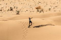 Man tourist in desert rub al khali Oman throwing sand 4 Royalty Free Stock Image