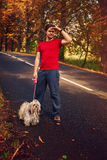 Man tourist with dog Stock Photo