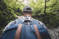 Man Tourist With Heavy Backpack Walking Through The Woods Wide Angle, Rear View Hiking Journey Travel Trek Concept Stock Photo