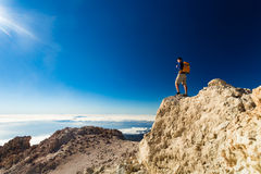 Man tourist hiker or trail runner looking at view. Stock Image