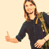 Man tourist hitchhiker with thumb up gesture. Stock Photo