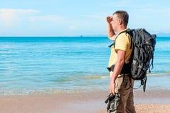 Man tourist on holiday. On a hike enjoys the sea Royalty Free Stock Image