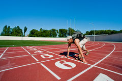 Man tourist kneeling on a starting grid Royalty Free Stock Images