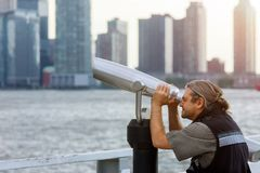 Man tourist looking through binoculars. on top of New York the Freedom Tower enjoying beautiful city landscape travel and royalty free stock photos